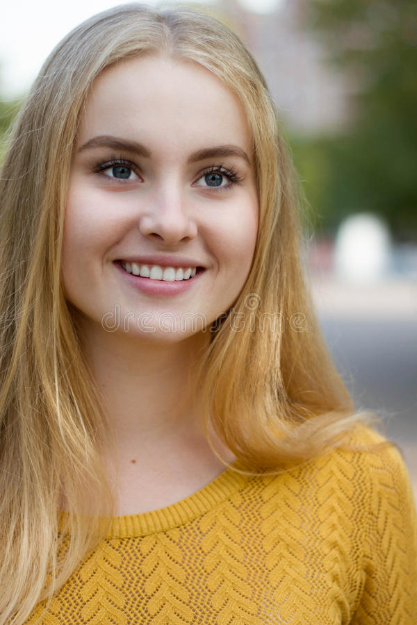 Beautiful sunny portrait of the blonde girl royalty free stock images