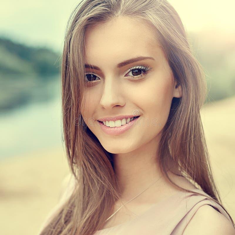 Beautiful sunny portrait of a pretty girl stock image