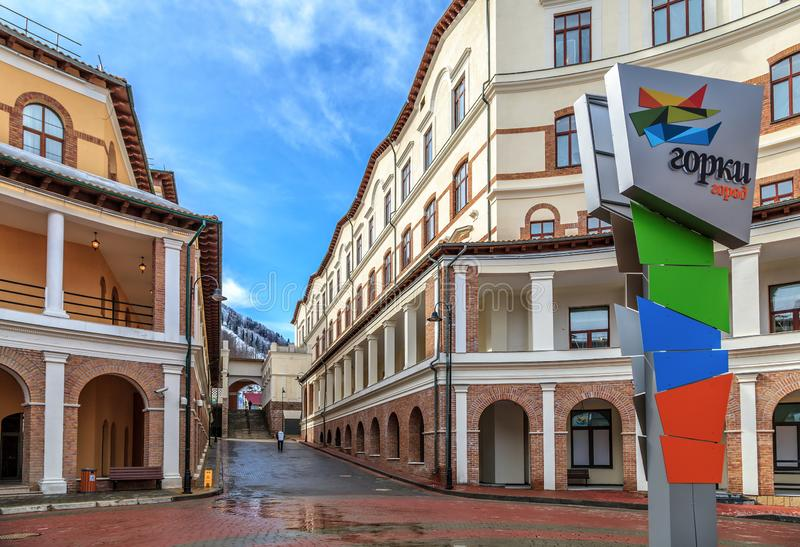 Beautiful sunny townscape of modern hotel and apartment buildings of Gorky Gorod mountain ski resort at spring. Street view with royalty free stock images