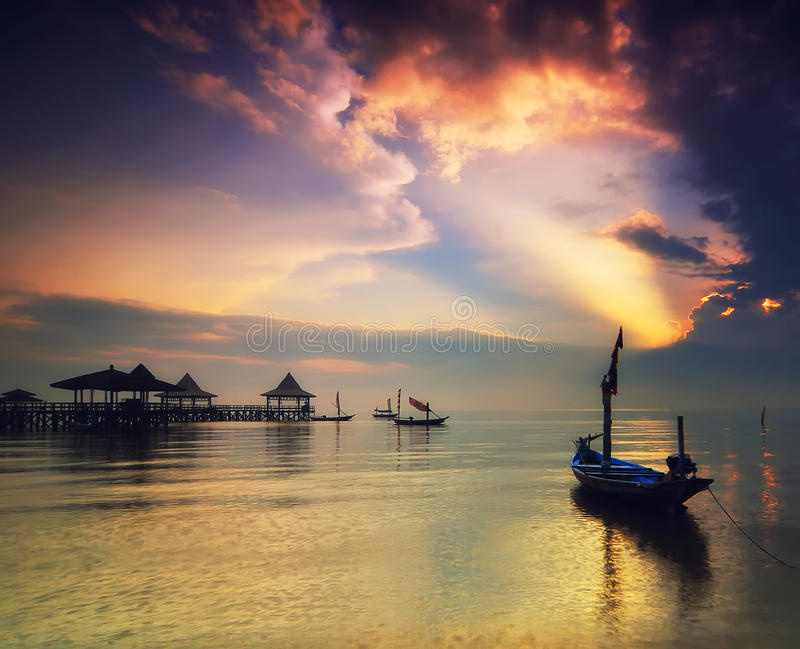 Beautiful Sunrise. That's not my boat but i wish it's mine, so i can see beautiful sunrise everyday royalty free stock photography
