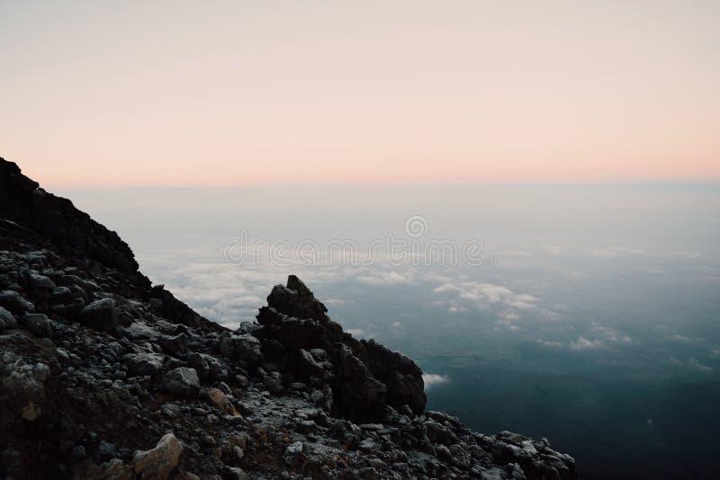 Sunrise above the clouds, Mount Meru. Beautiful sunrise above the clouds at Mount Meru, Arusha National Park, Tanzania royalty free stock photo