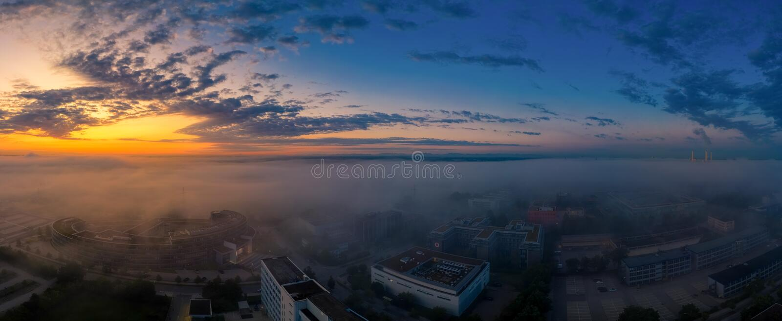 A beautiful sunrise as an aerial with a total view over fields, office buildings and a lake stock photos