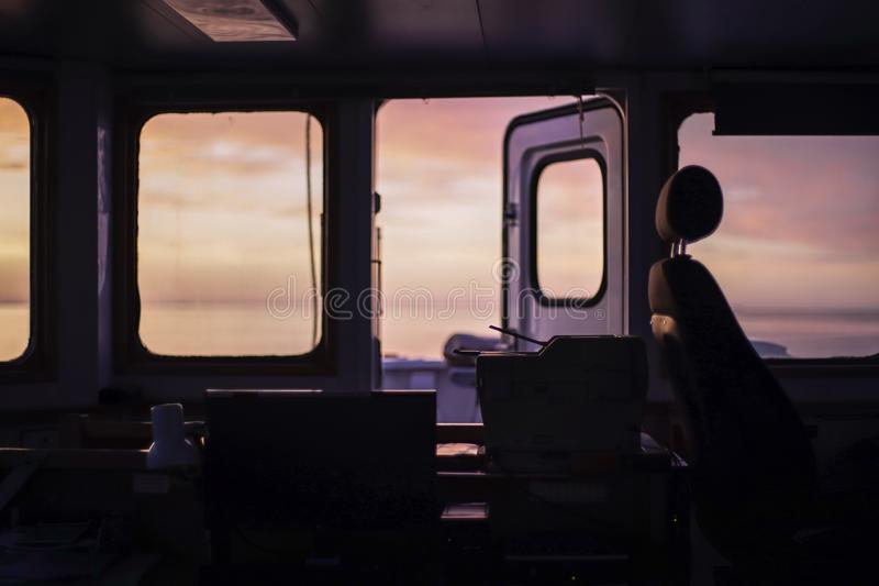 Beautiful sunrise at Baltic Sea. View from bridge of cargo vessel. During morning watch. Background. Blur stock images