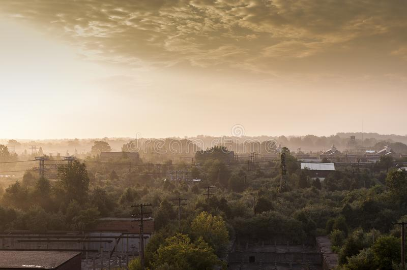 Sunrise with Buildings in Distant Background - Abandoned Indiana Army Ammunition Depot - Indiana stock photo