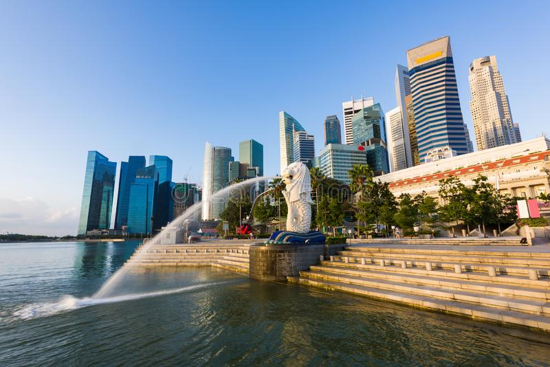 Beautiful sunrise of city skyline with Merlion, Singapore royalty free stock image