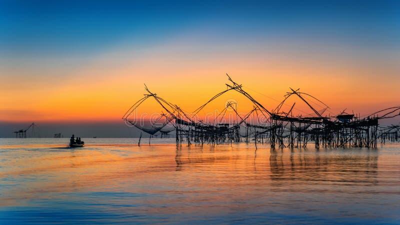 Beautiful sunrise and fishing dip nets at Pakpra in Phatthalung. Thailand stock photo