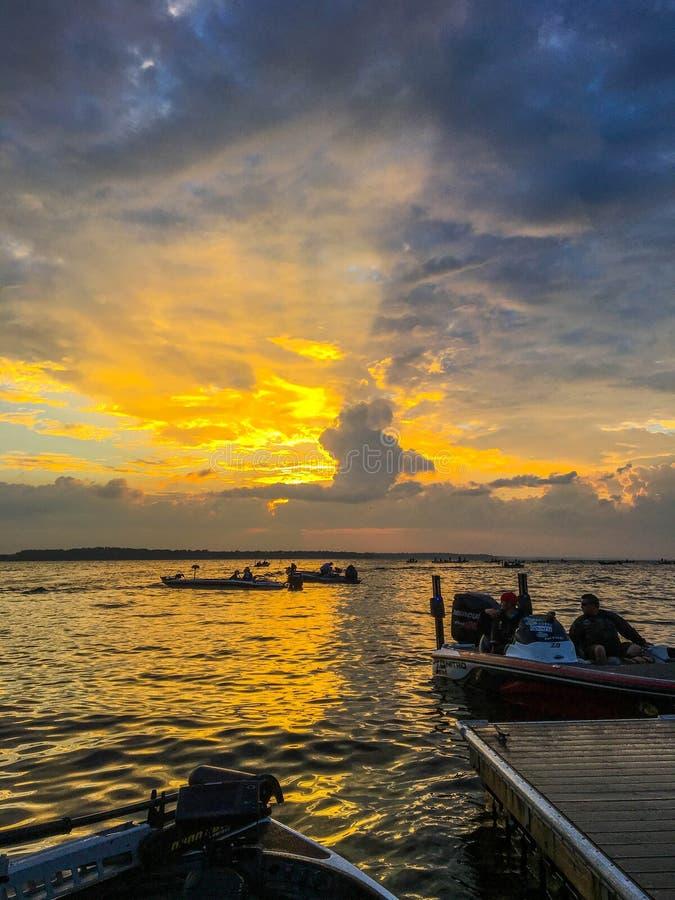 A beautiful sunrise on the lake. Bass fishing tournament getting ready to start on Lake Oneida NY at sunrise royalty free stock photo