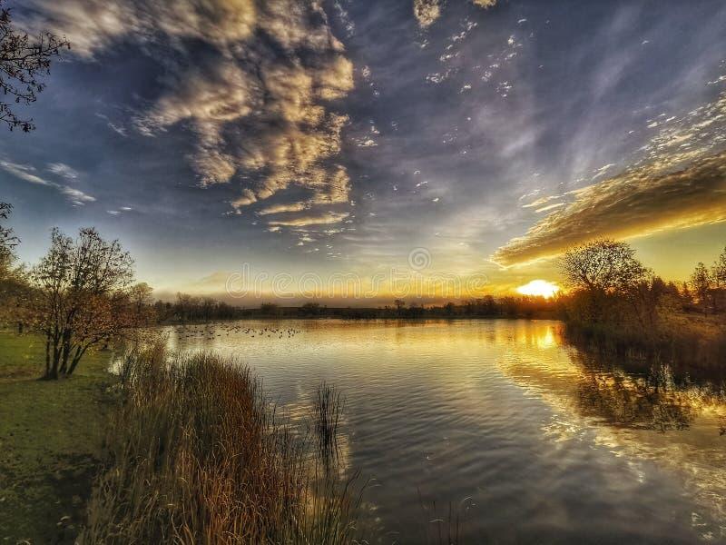 beautiful sunrise at the lake royalty free stock photos