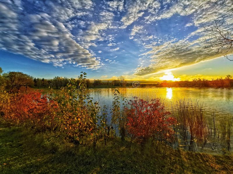 beautiful sunrise at the lake stock photos