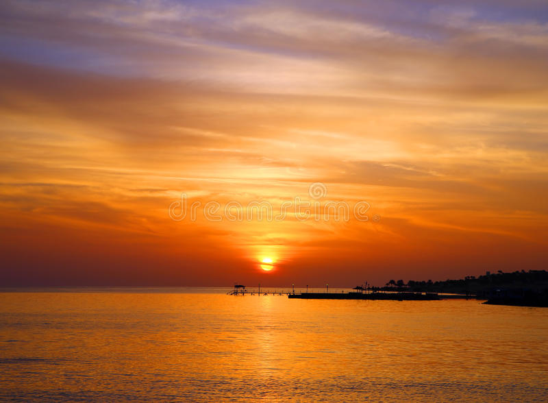 Beautiful sunrise landscape with pier royalty free stock images