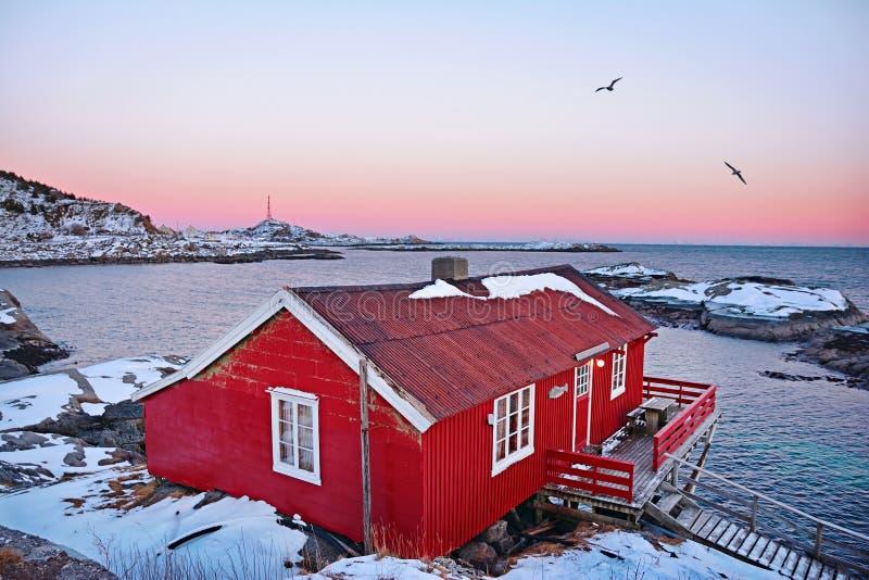 Beautiful sunrise landscape with traditional Norwegian fishing hut in Lofoten islands royalty free stock photo