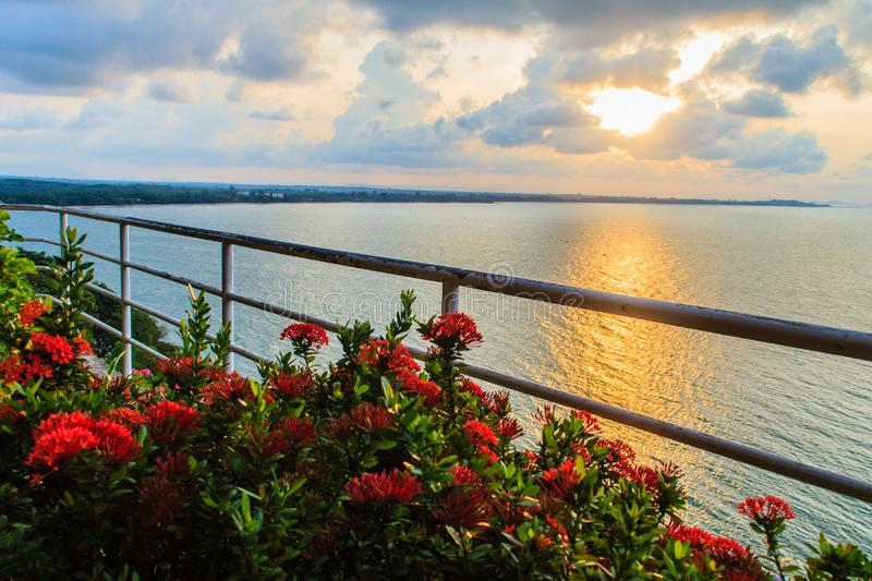 Beautiful sunrise in the morning that sun beams break through the colourful cloud and reflect yellow light of sunshine over the ga. Rden on the balcony at the royalty free stock images