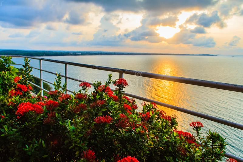 Beautiful sunrise in the morning that sun beams break through the colourful cloud and reflect yellow light of sunshine over the ga. Rden on the balcony at the stock image