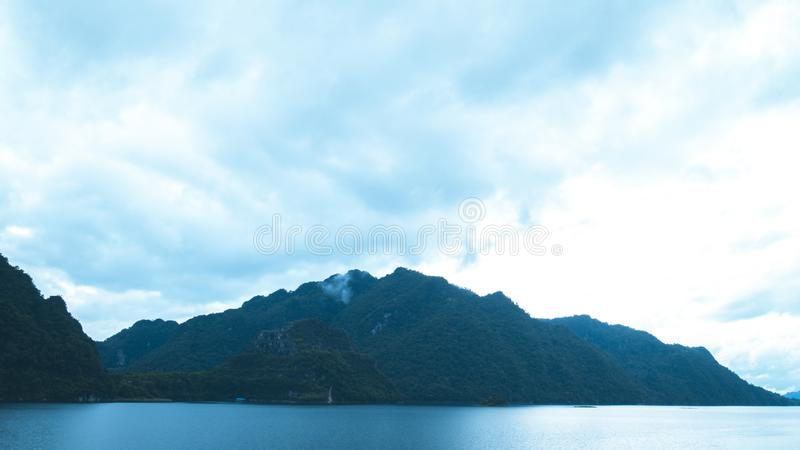 Beautiful sunrise at the mountains. Green landscape reflected at the lake. Nature background stock images