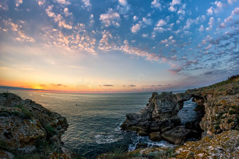 Beautiful sunrise over the Black Sea with rocks on the shore royalty free stock photography