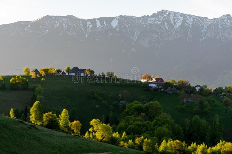 Beautiful sunrise over houses in Magura village, Romania, Europe royalty free stock image