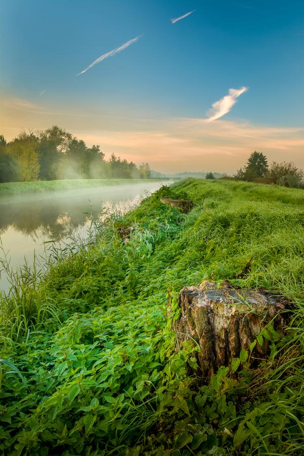 A beautiful sunrise over a misty meadow and a river royalty free stock photos