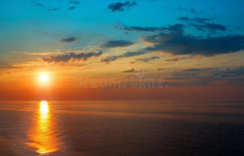Beautiful sunrise over the quiet calm sea. stock image