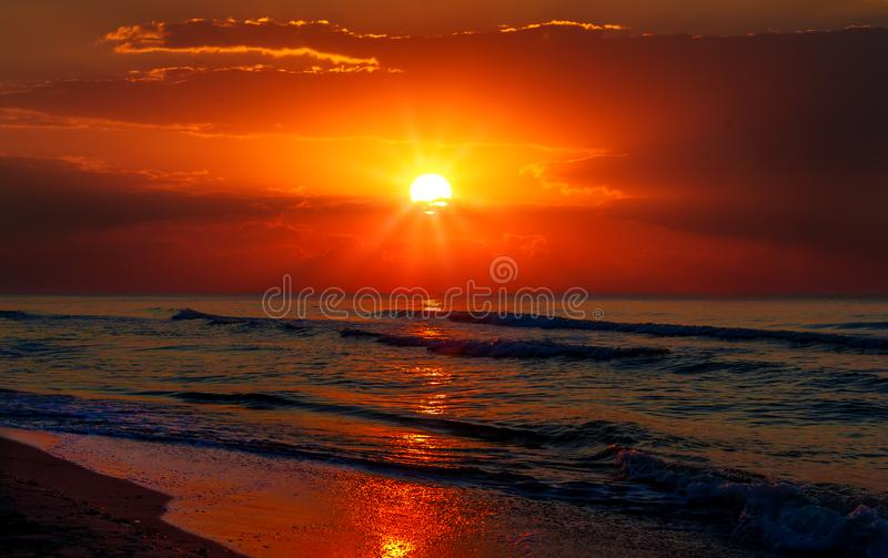 Beautiful sunrise over the quiet calm sea. royalty free stock images