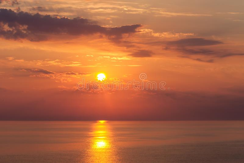 Beautiful sunrise over the quiet calm sea royalty free stock photography
