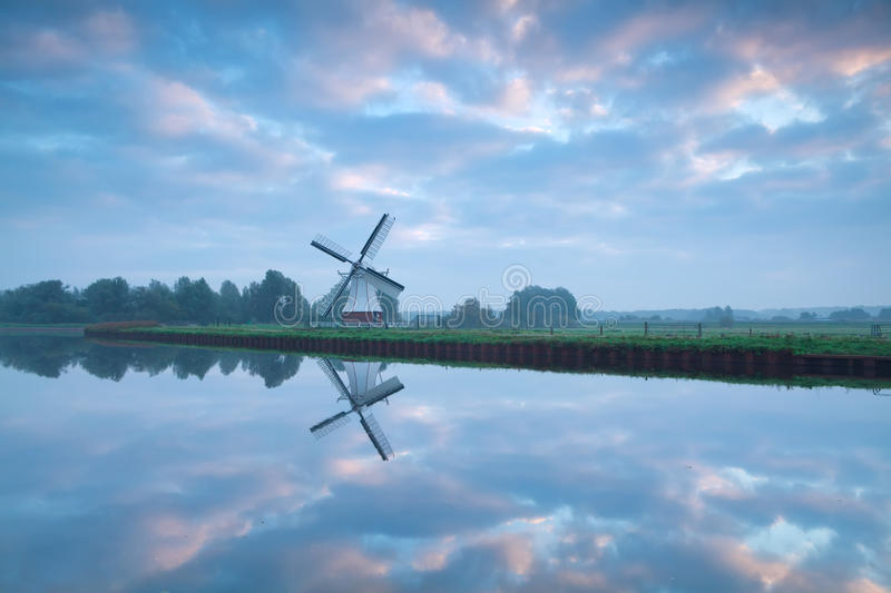Download Beautiful Sunrise Over River And Windmill Stock Image - Image: 34342879