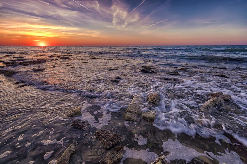 Sunrise over the sea with water motion blur royalty free stock photos