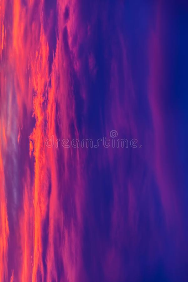Beautiful sunrise, photo rotated vertically. As an abstract background stock photos