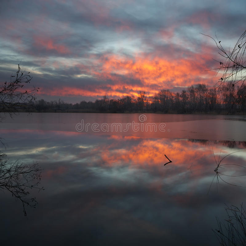 Beautiful sunrise on the pond. Heaven shall burn. Beautiful sunrise on the pond. Dnepropetrovsk Ukraine royalty free stock images