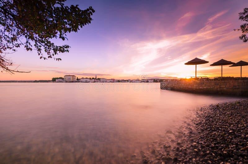 Beautiful sunrise at Porec in Adriatic sea coast of Croatia Euro. Morning by the coast looking at sunrise at old town of Porec - Croatia royalty free stock photography