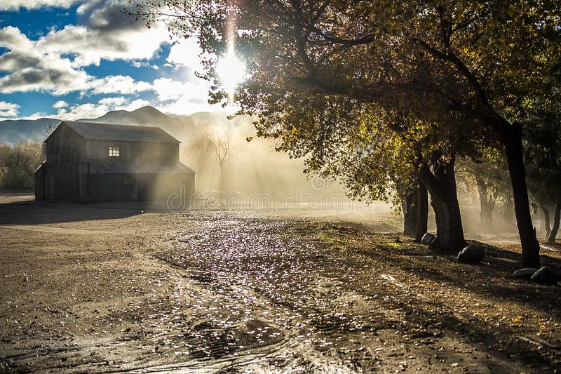 Beautiful sunrise in a ranch with a barn royalty free stock images