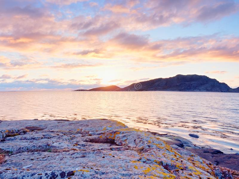 Beautiful sunrise on rocky shore and dramatic sky clouds. stock photography