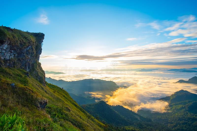 \'Beautiful sunrise scene at high mountain with yellow clouds and blue sky, Phu chi fah Chiangrai Thailand I. \'Beautiful sunrise scene at high mountain with stock photography