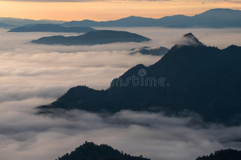 \'Beautiful sunrise scene at high mountain with yellow clouds and blue sky, Phu chi fah Chiangrai Thailand I. \'Beautiful sunrise scene at high mountain with stock images