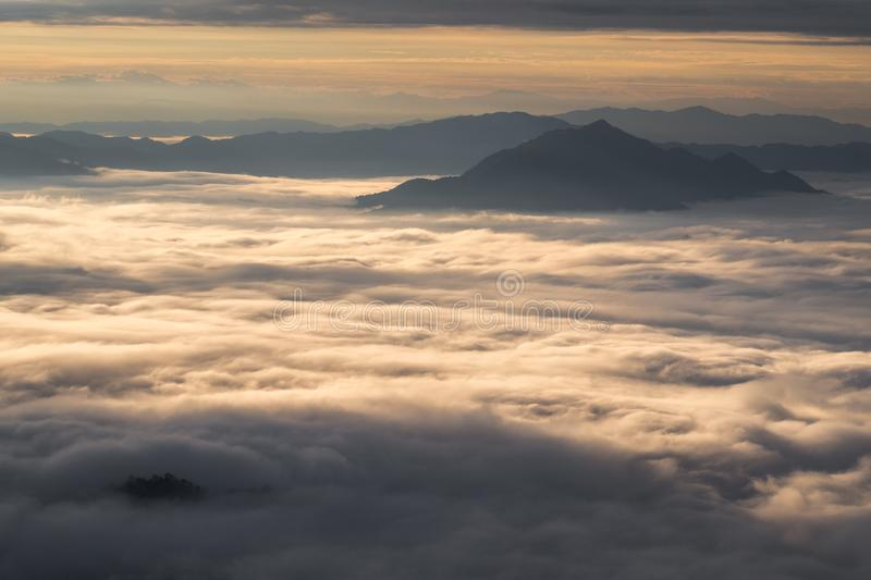 \'Beautiful sunrise scene at high mountain with yellow clouds and blue sky, Phu chi fah Chiangrai Thailand I. \'Beautiful sunrise scene at high mountain with royalty free stock photos