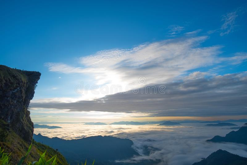 \'Beautiful sunrise scene at high mountain with yellow clouds and blue sky, Phu chi fah Chiangrai Thailand I. \'Beautiful sunrise scene at high mountain with royalty free stock images