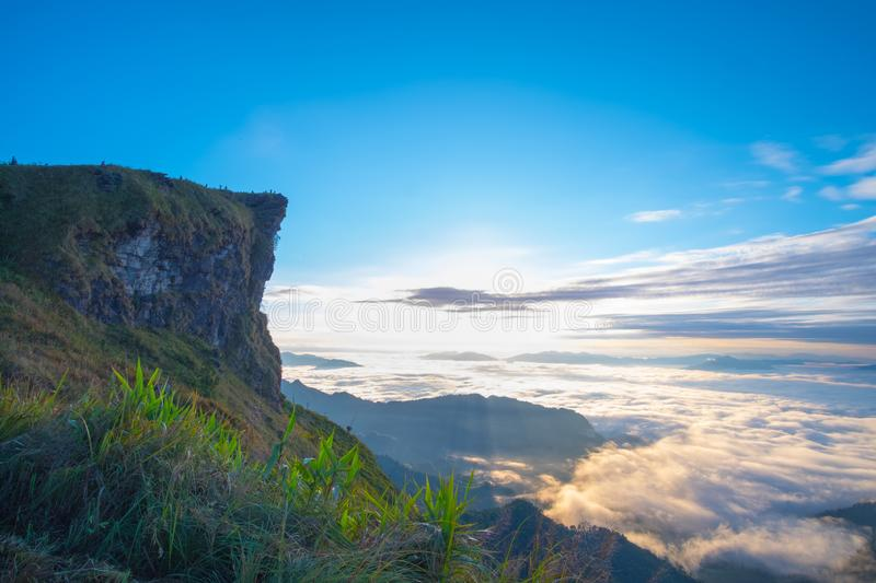 \'Beautiful sunrise scene at high mountain with yellow clouds and blue sky, Phu chi fah Chiangrai Thailand I. \'Beautiful sunrise scene at high mountain with stock photos