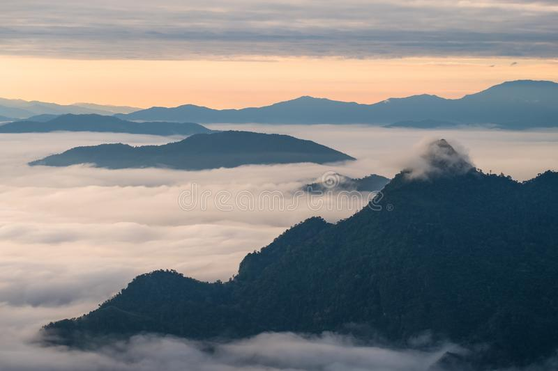 \'Beautiful sunrise scene at high mountain with yellow clouds and blue sky, Phu chi fah Chiangrai Thailand I. \'Beautiful sunrise scene at high mountain with royalty free stock image