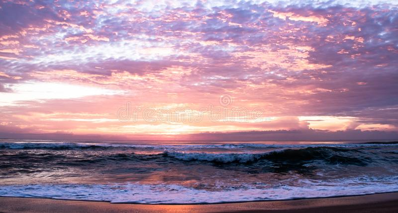 Beautiful sunlight and sky cloud background over sea beach in the morning at Ban Krut Beach, Prachuapkirikhan, south of Thailand. Beautiful sunrise and royalty free stock photography