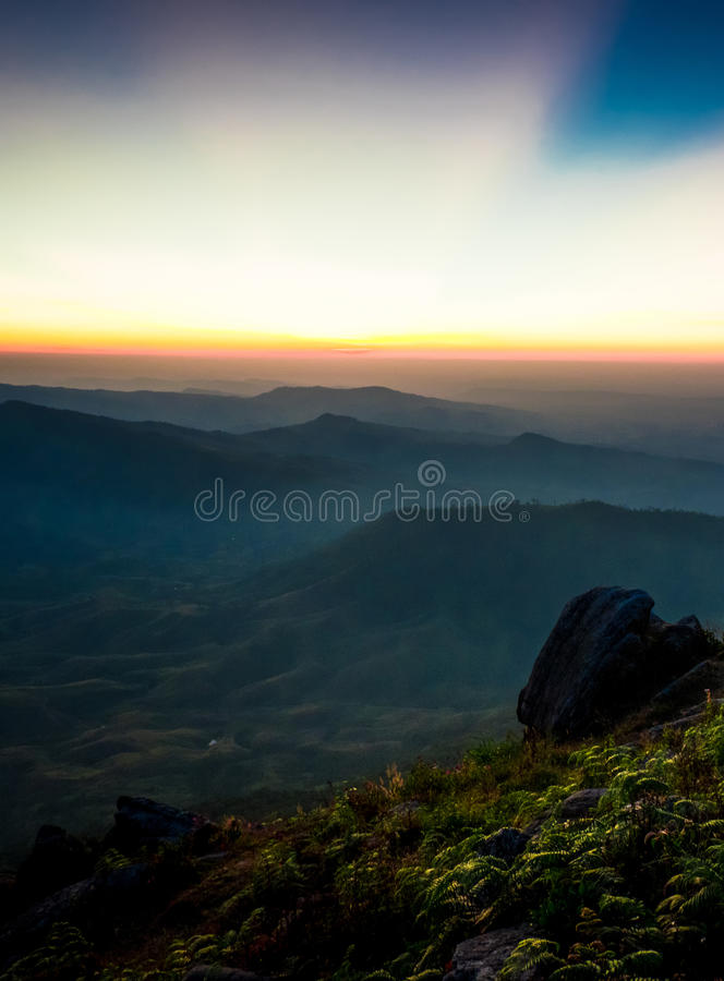 Beautiful sunrise. Beautiful sun rise on top of the mountain royalty free stock images