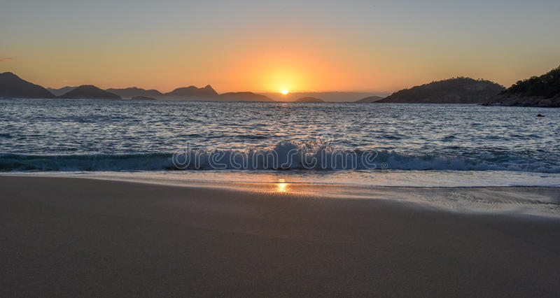 Beautiful Sunrise with the sun rising out of the ocean, Rio de Janeiro stock images