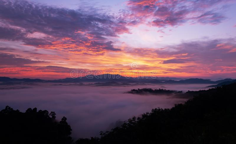 Beautiful sunrise or sunset with fog flowing in the mountain bea. Utiful landscape scenery view in thailand stock image