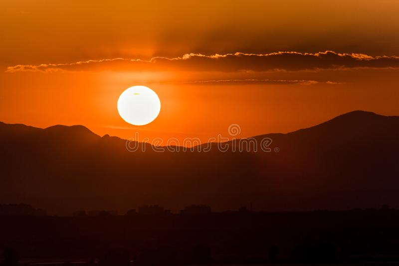 Beautiful sunrise or sunset on mountain background and dramatic clouds on the sky stock photos