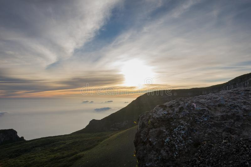 Beautiful sunrise view from top of Gede Pangrango Mountain. Nature hiking peak travel sky landscape fog rock clouds trek outdoors vivid season tourism volcano stock photography