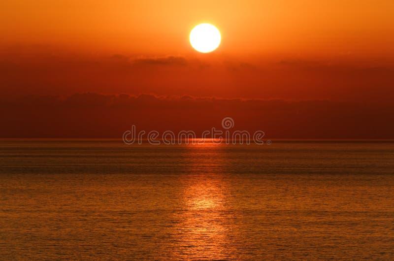 Beautiful sunset above the tyrrhenian sea. View from Riaci beach near Tropea, Italy stock photo