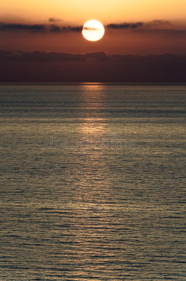 Beautiful sunset above the tyrrhenian sea. View from Riaci beach near Tropea, Italy stock photography