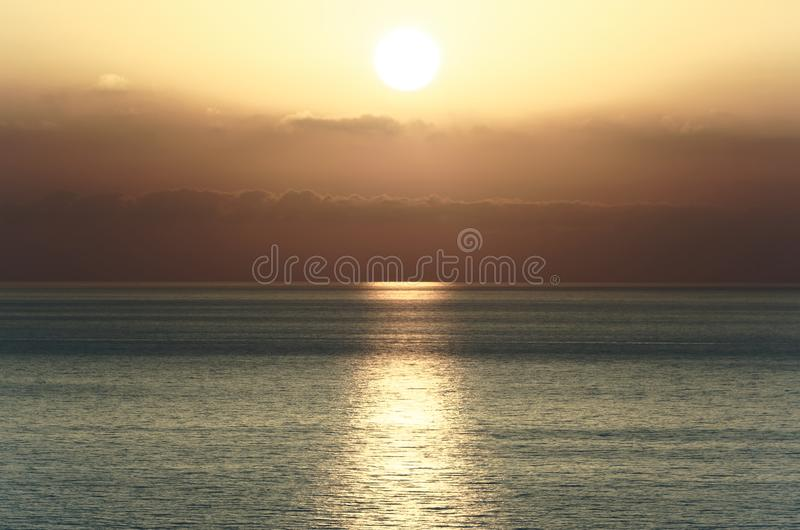 Beautiful sunset above the tyrrhenian sea. View from Riaci beach near Tropea, Italy stock images