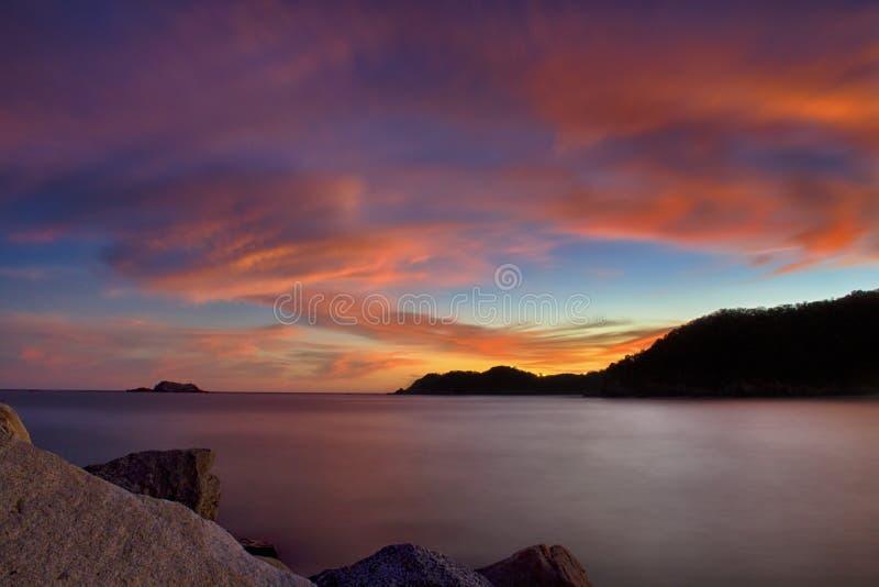 Beautiful sunset, Bahia Chahue. Huatulco, Oaxaca, Mexico. Located east of Bahia Tangolunda. Background, bay, beach, beauty, blue, central, coast, coastline royalty free stock photography
