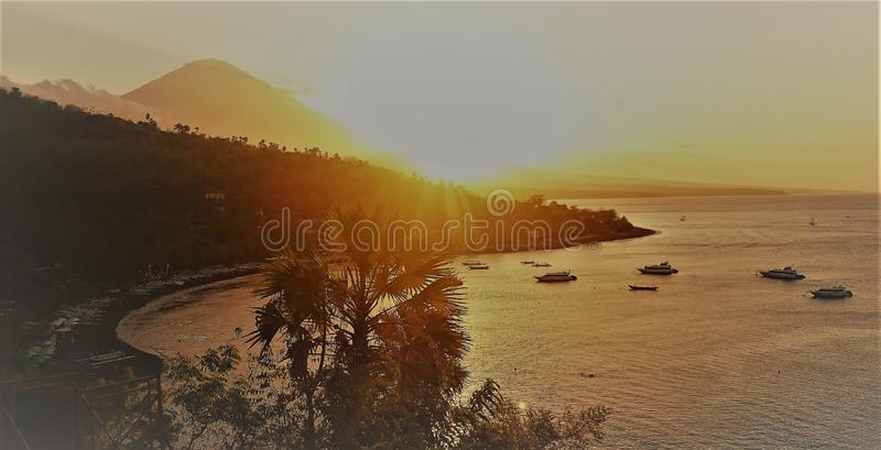 Beautiful Sunset in the bay of Amed, vulcano sea sun beach landscape Bali, Indonesia royalty free stock image