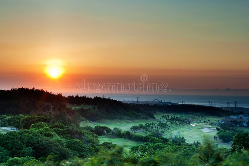 Beautiful sunset beside beach. Golf place beside beach with beautiful sunset stock image