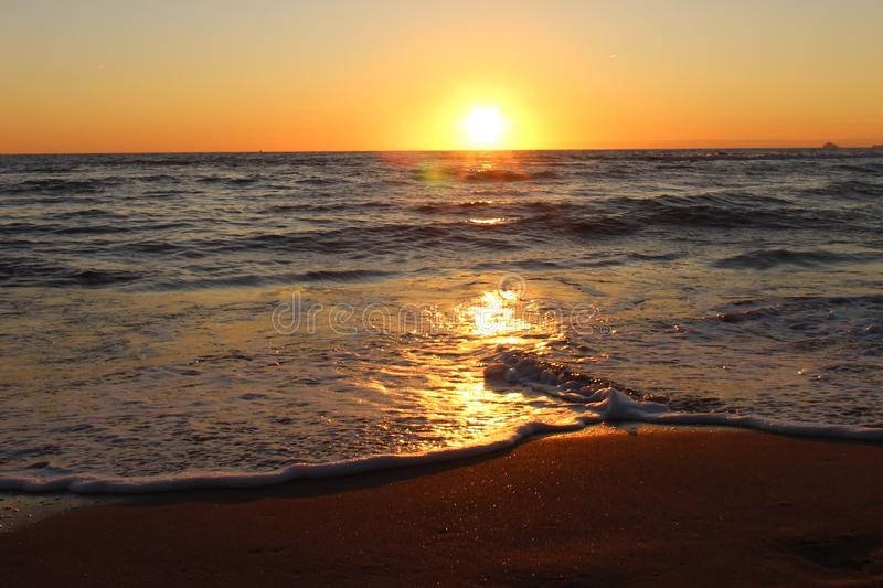 The beautiful sunset on the beach. stock photography